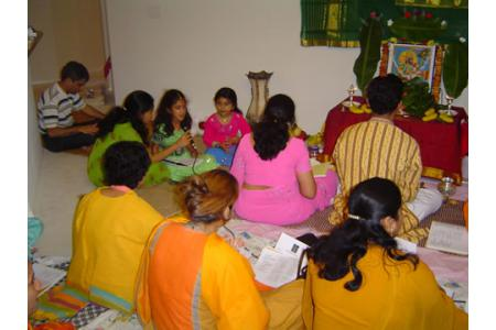 Singing Bhajans at a Bhajan Evening.