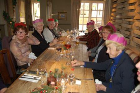 Members and volunteers enjoying a Christmas lunch
