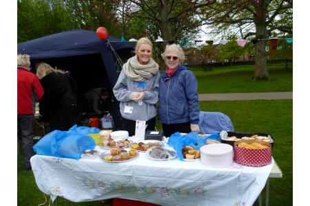 Volunteers selling cakes to raise money