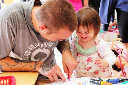 Father and daugher enjoy art workshop