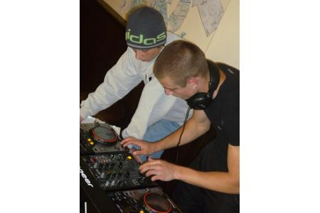 Young person learning DJ skills